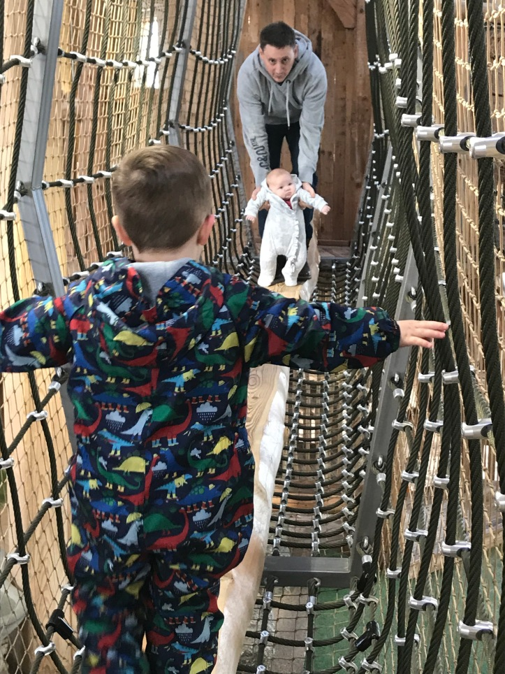 Little L and Spud tackling the wooden beam with Daddy. Walking through a net tunnel