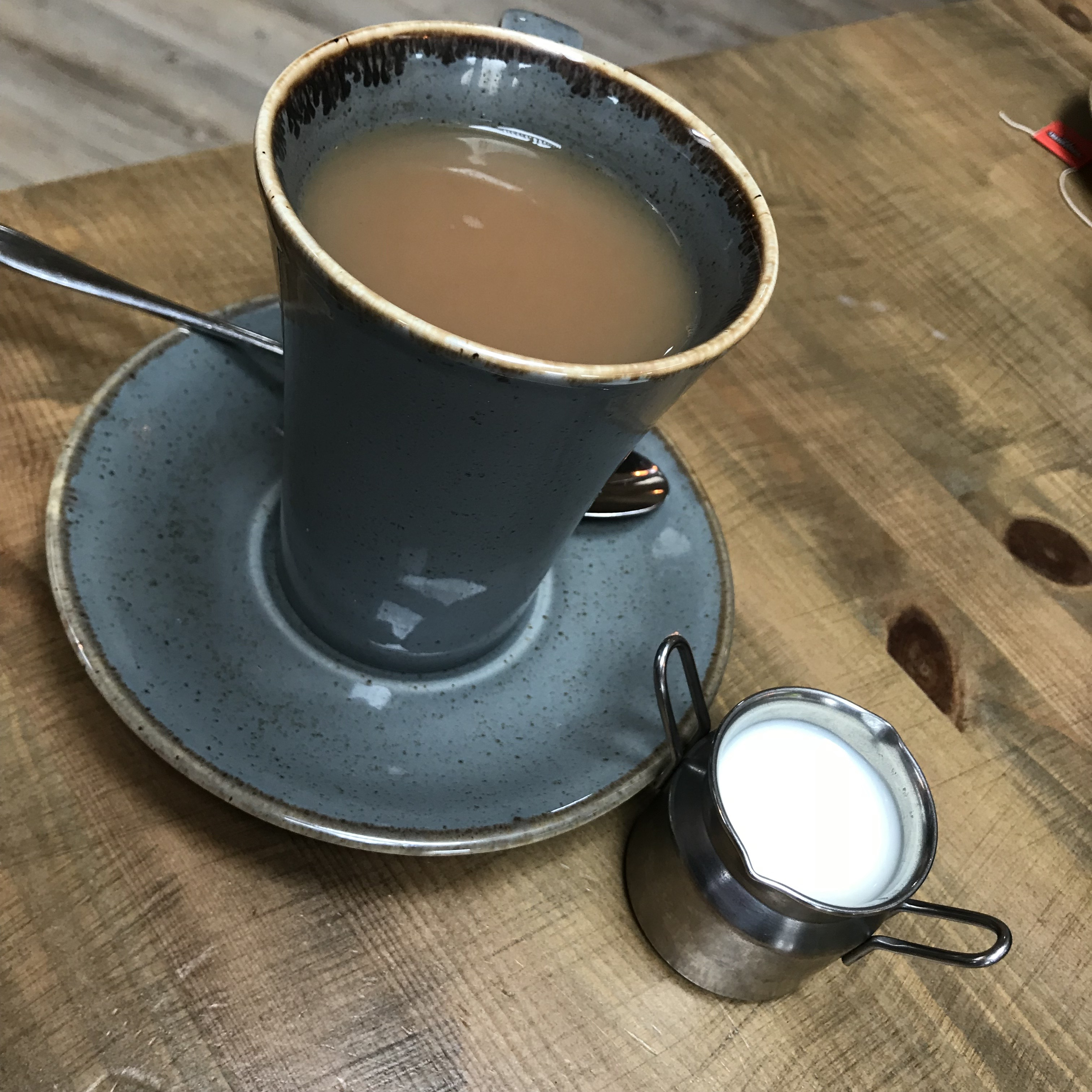 mug of tea and milk in a little jug